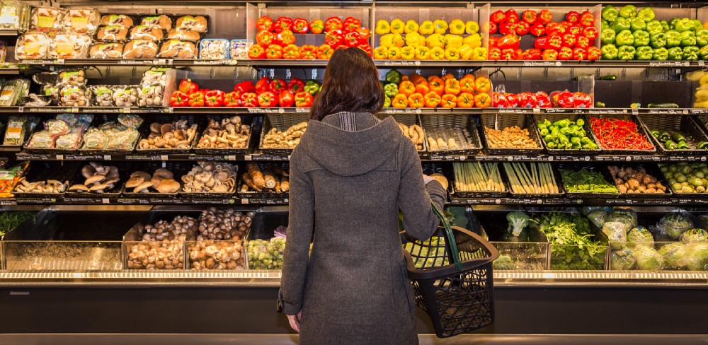 woman at the vegetable aisle in a grocery