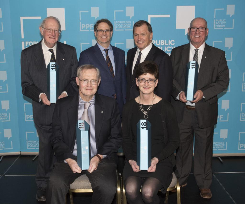 The four 2018 Frank McKenna Award honourees, Edward Greenspon and Frank McKenna pose for a photo