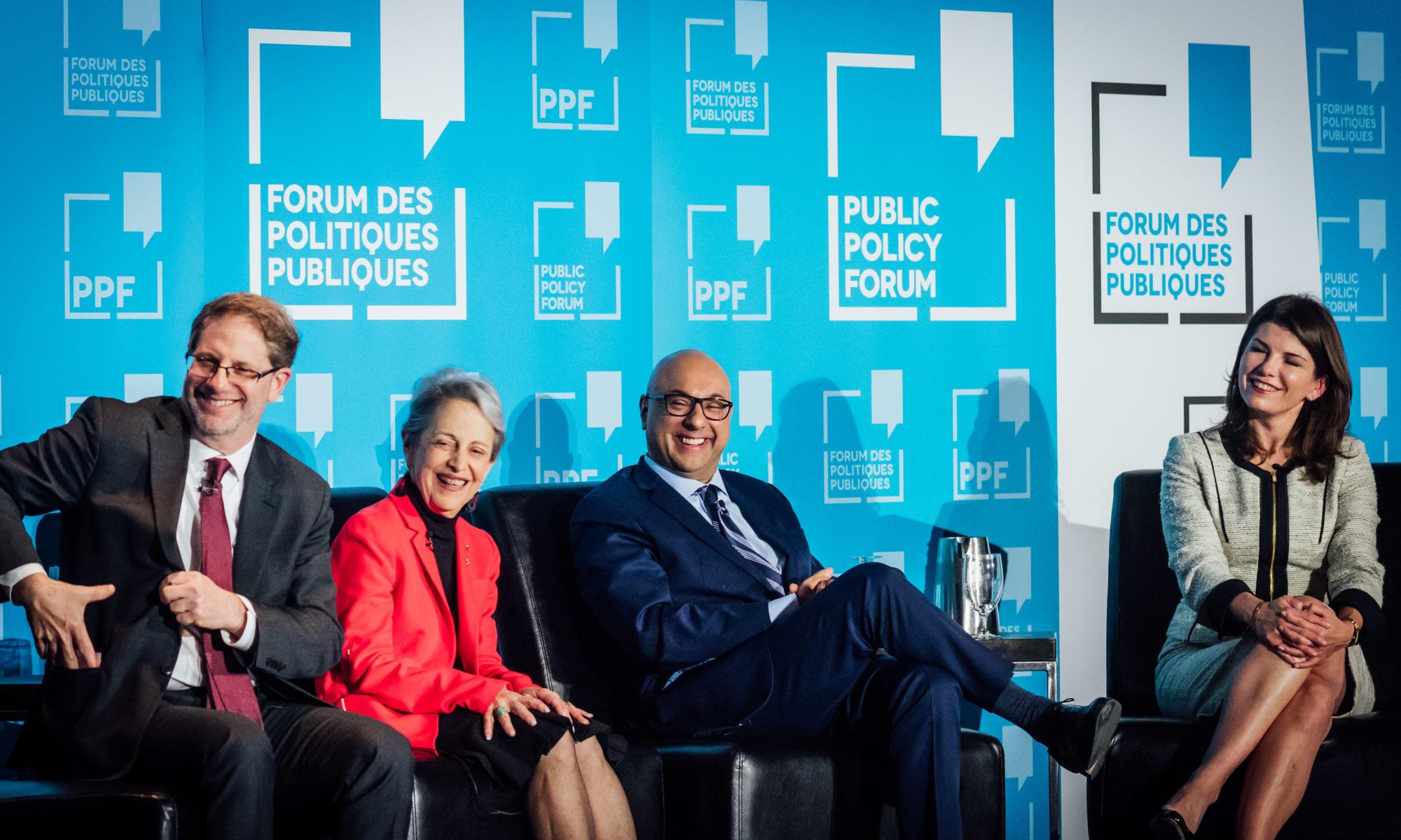Edward Greenspon, Janice Stein, Ali Velshi and Luiza Savage smile on stage