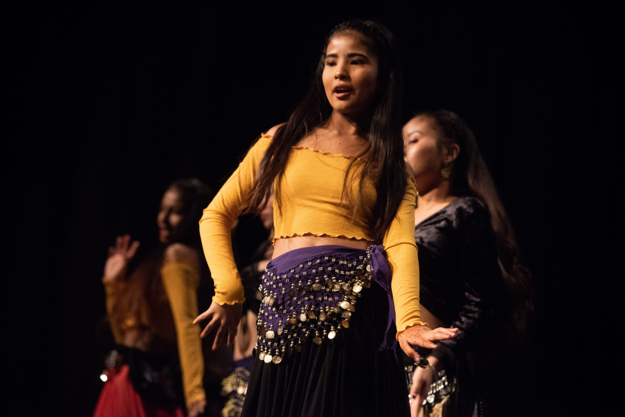 Dancers in yellow and purple ethnic costumes at Diwali festival in Halifax
