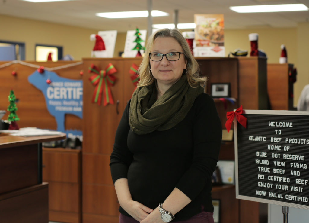 Diane Thibeault is head of human resources Atlantic Beef Products stands in the company's offices near a sign that reads in part Now Halal Certified.