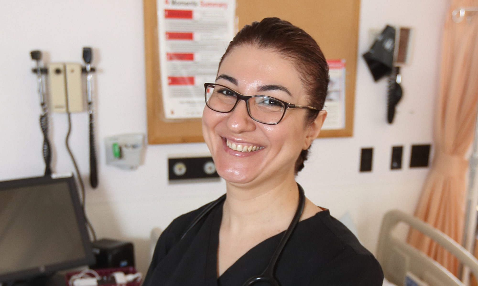 Nadine Ezzeddine poses inside the Nursing Simulation lab at Dalhousie University on March 20, 2019 in Halifax, Nova Scotia, where she teaches. When Ezzeddine arrived in Canada with years of health care experience and three degrees, she struggled to find work as a nurse. Now employed and on track to become a permanent resident, her advice for others is to 'be patient'. Photo by Mike Dembeck.