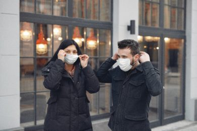 1 woman and 2 man wearing protective face masks
